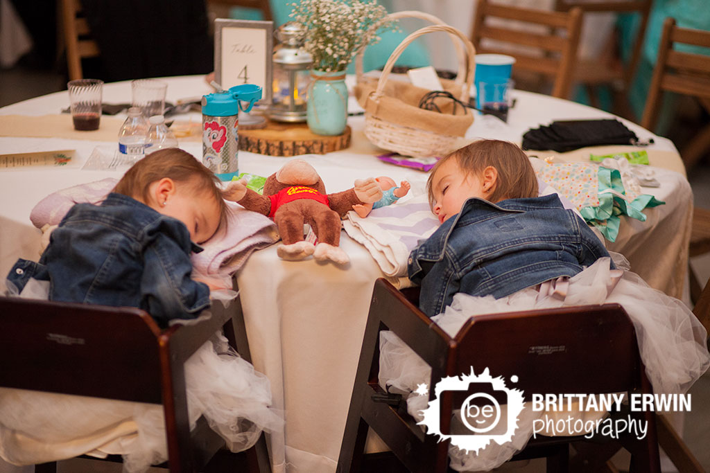 Barn-at-Kennedy-Farm-flower-girls-asleep-in-high-chair-at-table-party.jpg
