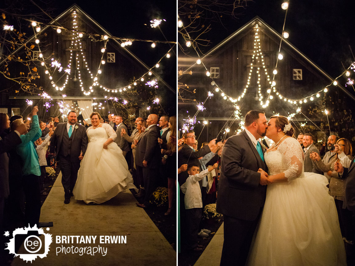 Barn-at-Kennedy-Farm-sparkler-exit-kiss-bride-and-groom-outdoor.jpg
