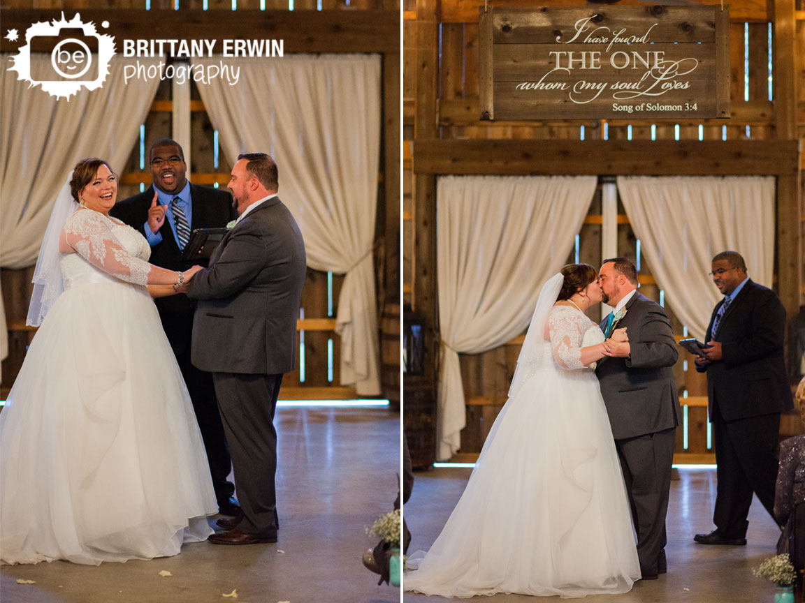 Barn-at-Kennedy-Farm-wedding-ceremony-photographer-first-kiss-bride-and-groom-indoor.jpg