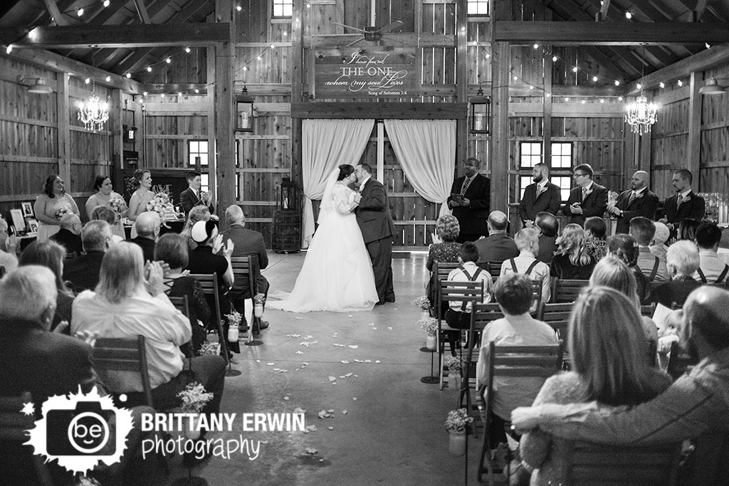 Barn-at-Kennedy-Farm-wedding-ceremony-photographer-first-kiss-husband-and-wife.jpg