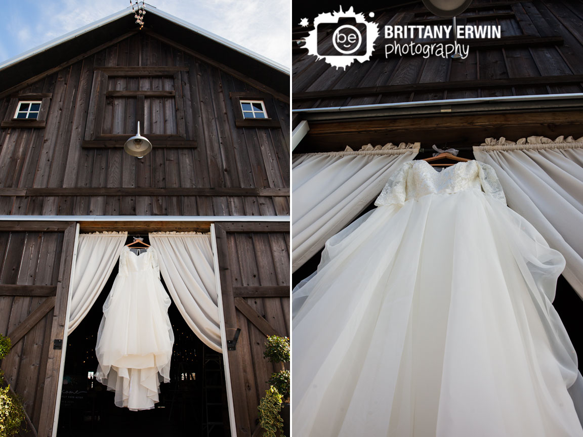 Barn-at-Kennedy-Farm-wedding-dress-detail-hanging-in-doorway.jpg