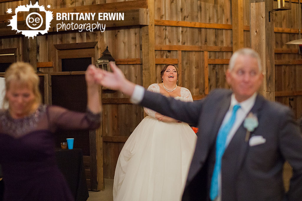 Barn-at-Kennedy-Farm-wedding-photographer-bride-reaction-parent-dance.jpg
