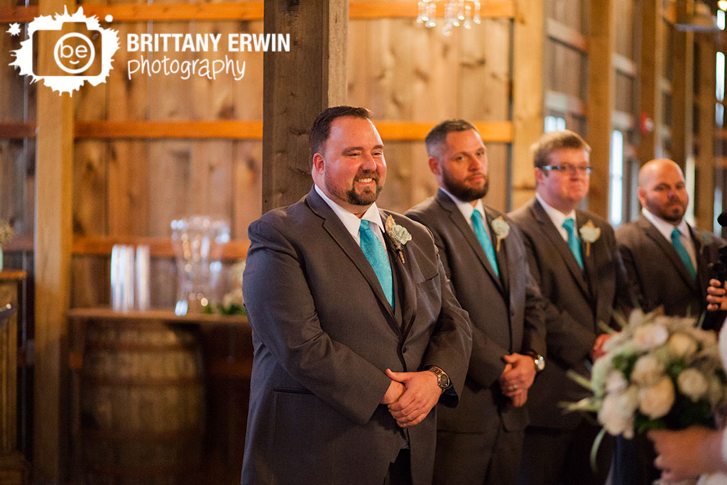 Barn-at-Kennedy-Farm-wedding-photographer-ceremony-groom-reaction-bride-walking-down-aisle.jpg