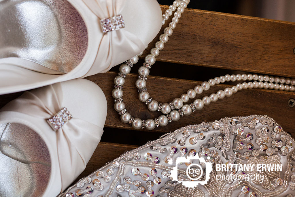 Barn-at-Kennedy-Farm-wedding-photographer-detail-white-shoes-pearl-necklace-blink-purse.jpg
