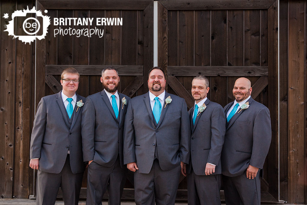Barn-at-Kennedy-Farm-wedding-photographer-groom-groomsement-in-front-of-doors.jpg