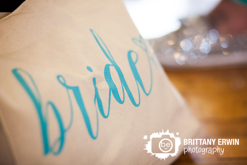 Sage-a-salon-wedding-photographer-bride-bag-detail-shiny-shoes.jpg