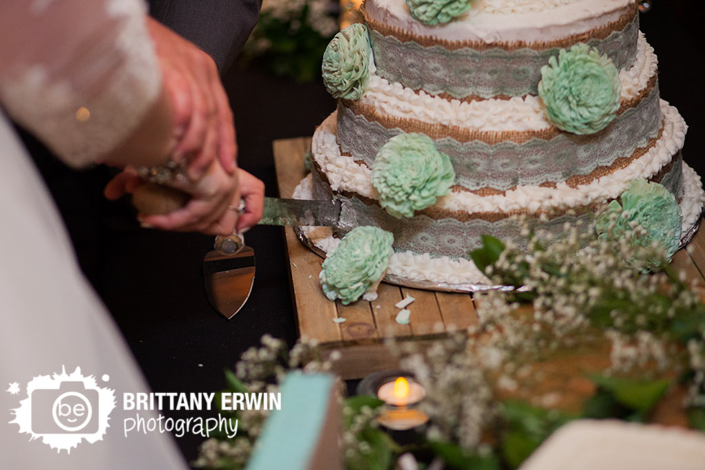 The-Barn-at-Kennedy-Farm-wedding-photography-bride-and-groom-cut-cake-reception.jpg