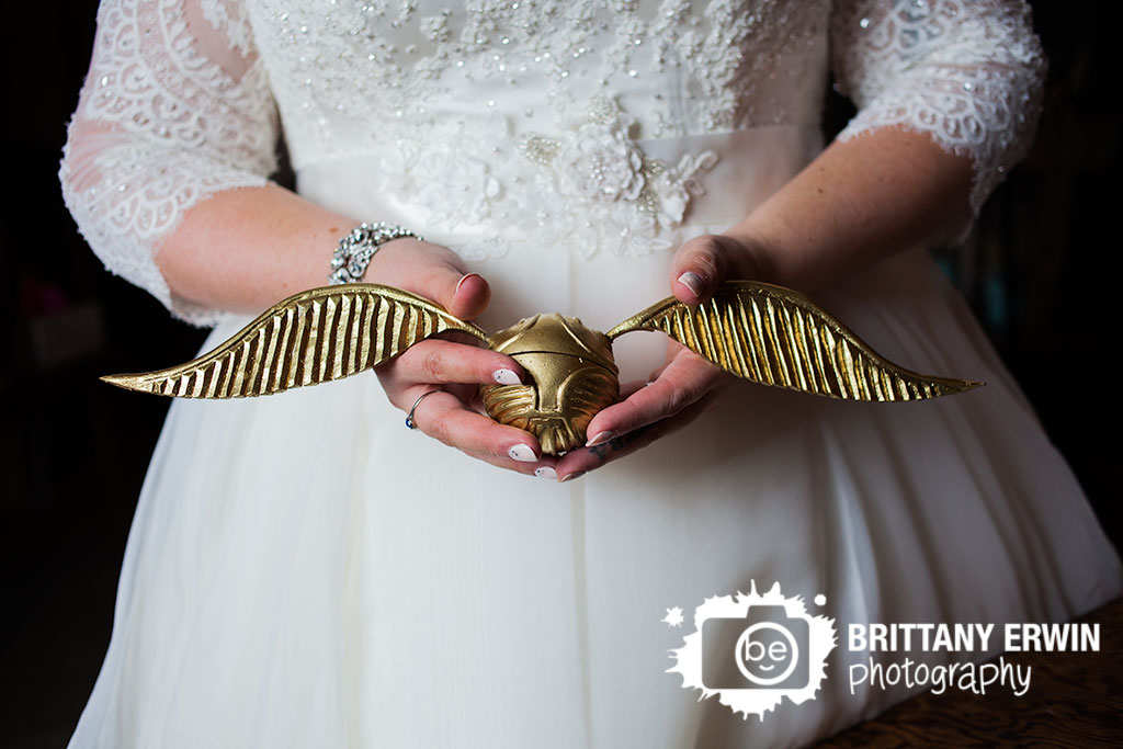 Barn-at-Kennedy-Farm-golden-snitch-ring-box-detail-photo-bride-holding-quiddich-wedding-photographer.jpg