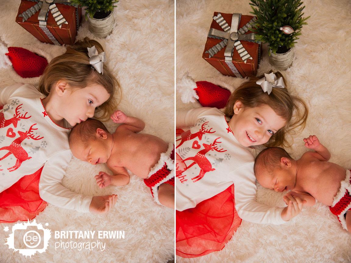 Speedway-Indiana-christmas-newborn-boy-with-sister-portrait-photographer-santa-hat.jpg