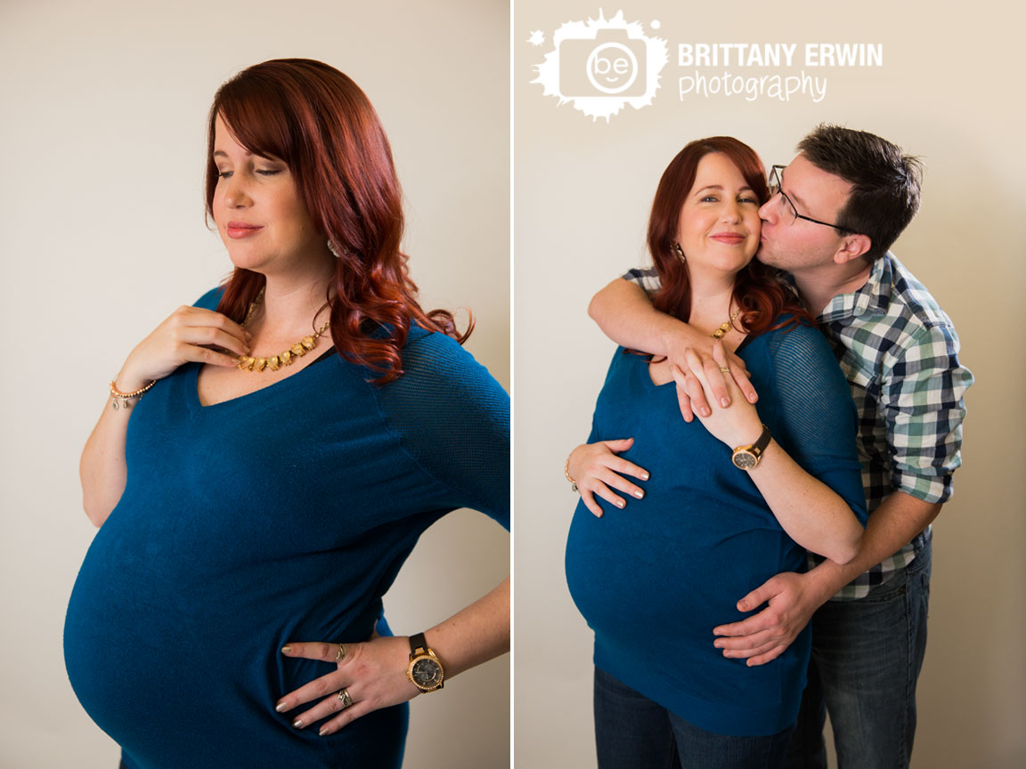 Speedway-Indiana-maternity-portrait-photographer-studio-white-backdrop-couple-cheek-kiss.jpg