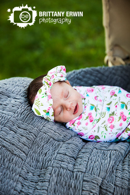 Speedway-Indiana-studio-portrait-photographer-newborn-baby-girl-floral-wrap-headband-antique-pram-asleep-outside.jpg