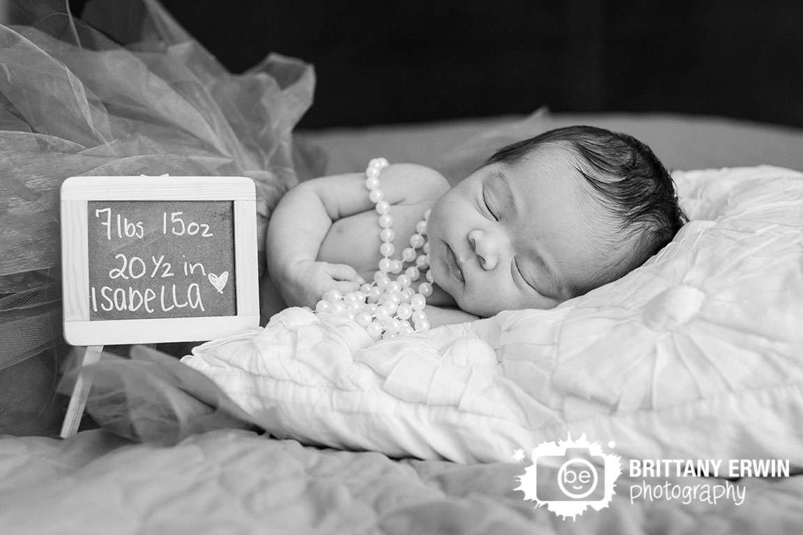 Indianapolis-lifestyle-in-home-newborn-portrait-photographer-baby-girl-sign-pearl-necklass-tutu.jpg