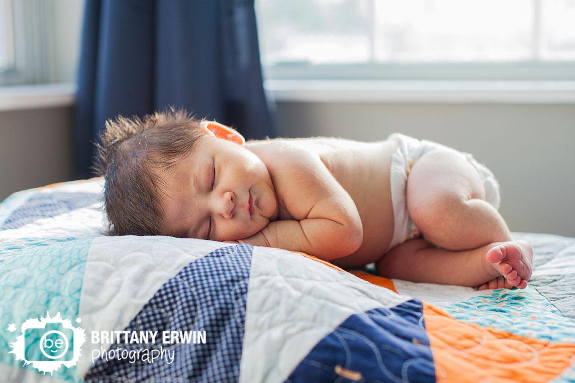 Indianapolis-lifestyle-newborn-baby-boy-portrait-photographer-asleep-handmade-quilt-blanket-in-window.jpg