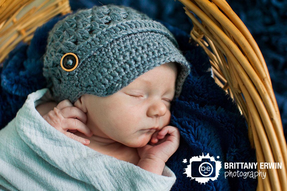 Indianapolis-lifestyle-photographer-newborn-baby-boy-sleep-gray-hat-basket-nursery.jpg