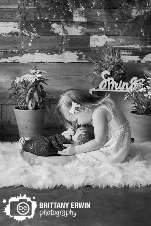 Indianapolis-studio-portrait-photographer-baby-boy-big-sister-newborn-spring-rustic-barn-wall.jpg