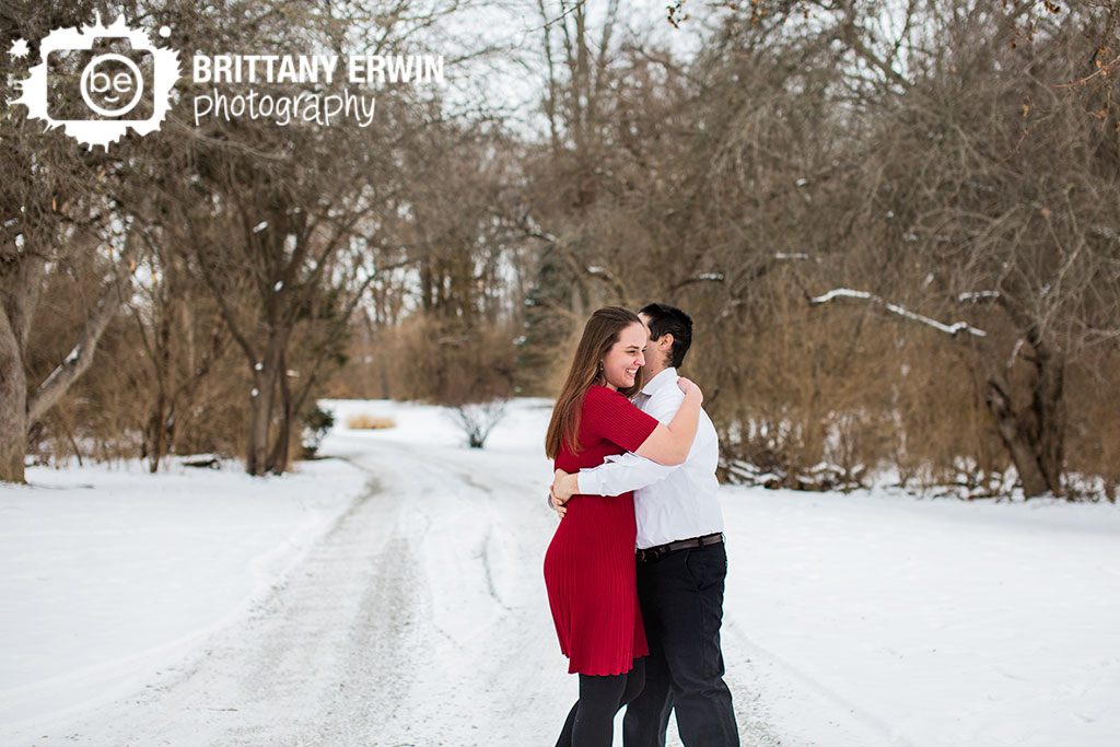 Indianapolis-couple-outdoor-winter-engagement-session-dancing-fun-in-snow.jpg
