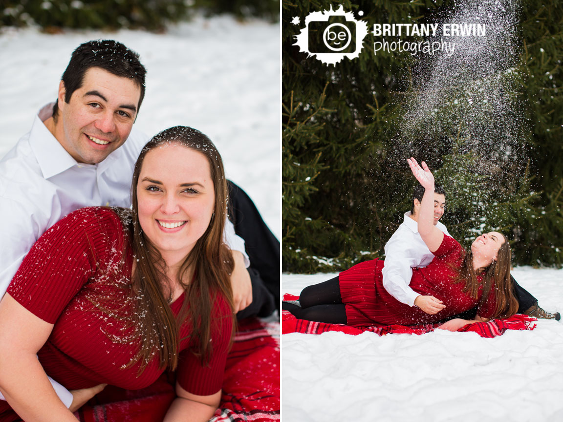 Indianapolis-winter-engagement-portrait-photographer-couple-play-in-snow-throw-into-air.jpg