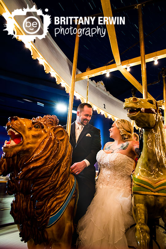 Indianapolis-Childrens-museum-wedding-couple-bride-on-carosel-portrait-photographer-fun-tattoo-lion.jpg