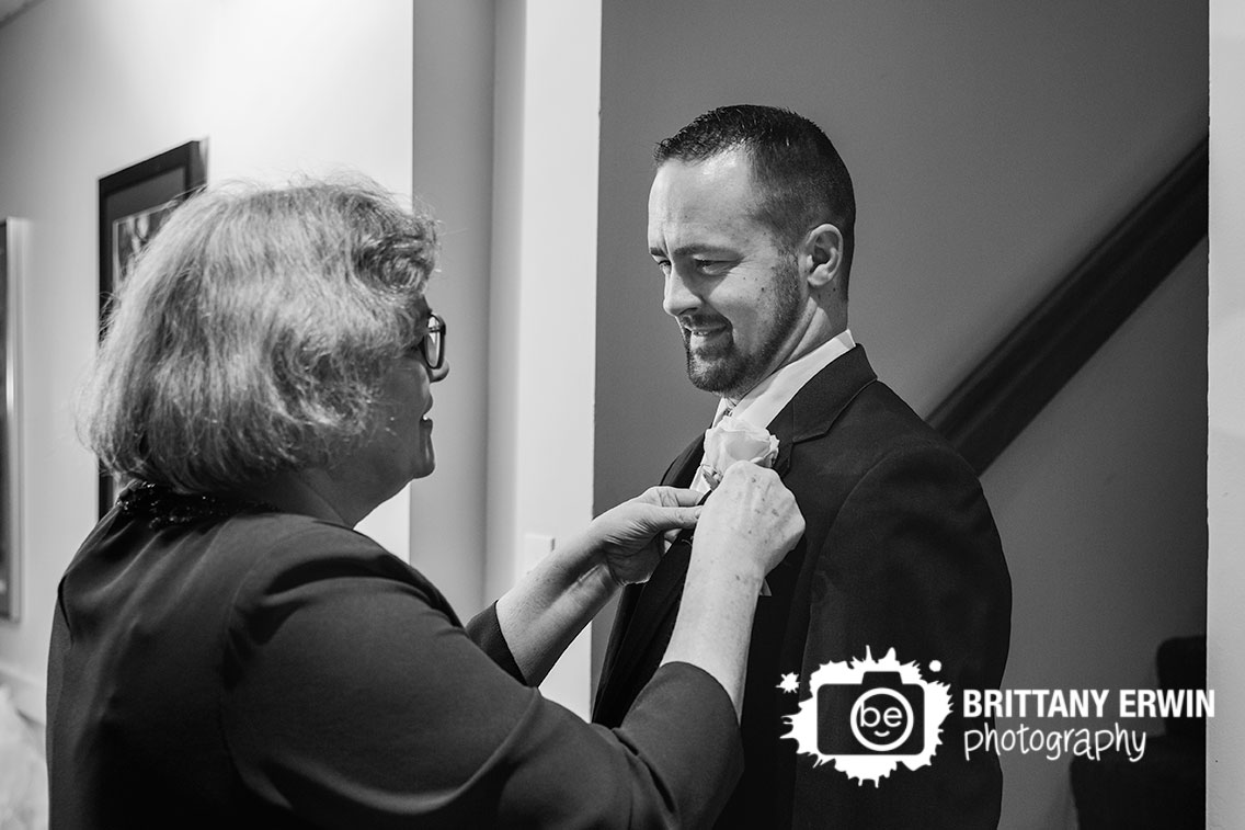 Indianapolis-wedding-photographer-mother-of-groom-pin-boutonniere-pin-ricks-cafe-boatyard.jpg