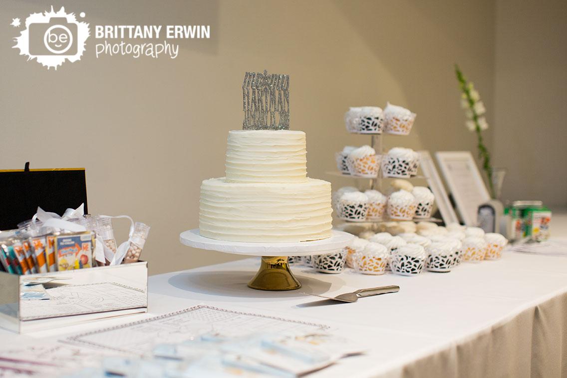 Ricks-cafe-boatyard-wedding-photographer-white-cake-glitter-custom-topper-dessert-table.jpg