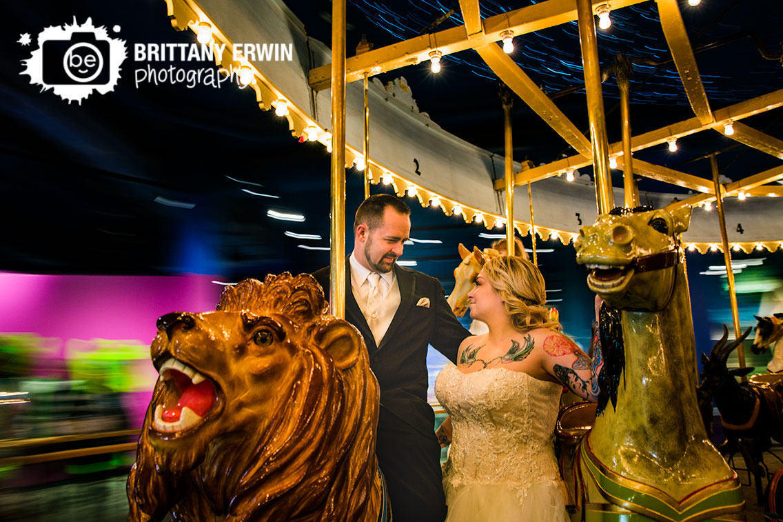 Indianapolis-childrens-museum-carousel-photographer-couple-ride-lion.jpg