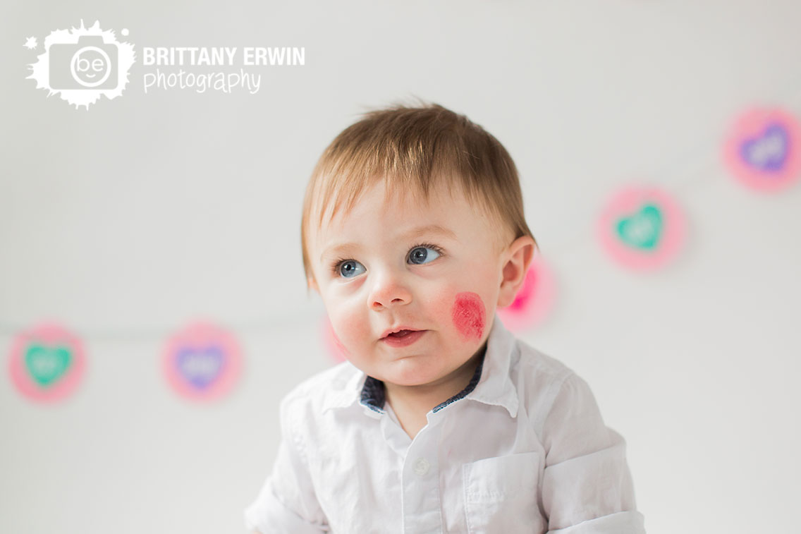 Indianapolis-valentines-day-baby-boy-portrait-lipstick-cheek-kiss-portrait-photographer-white-backdrop.jpg