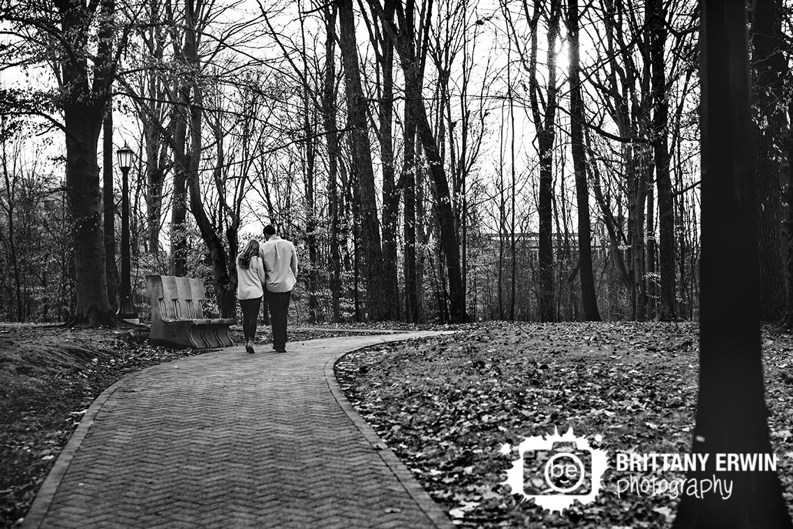 Bloomington-Indiana-University-campus-photographer-engagement-couple-walking-down-romantic-path.jpg