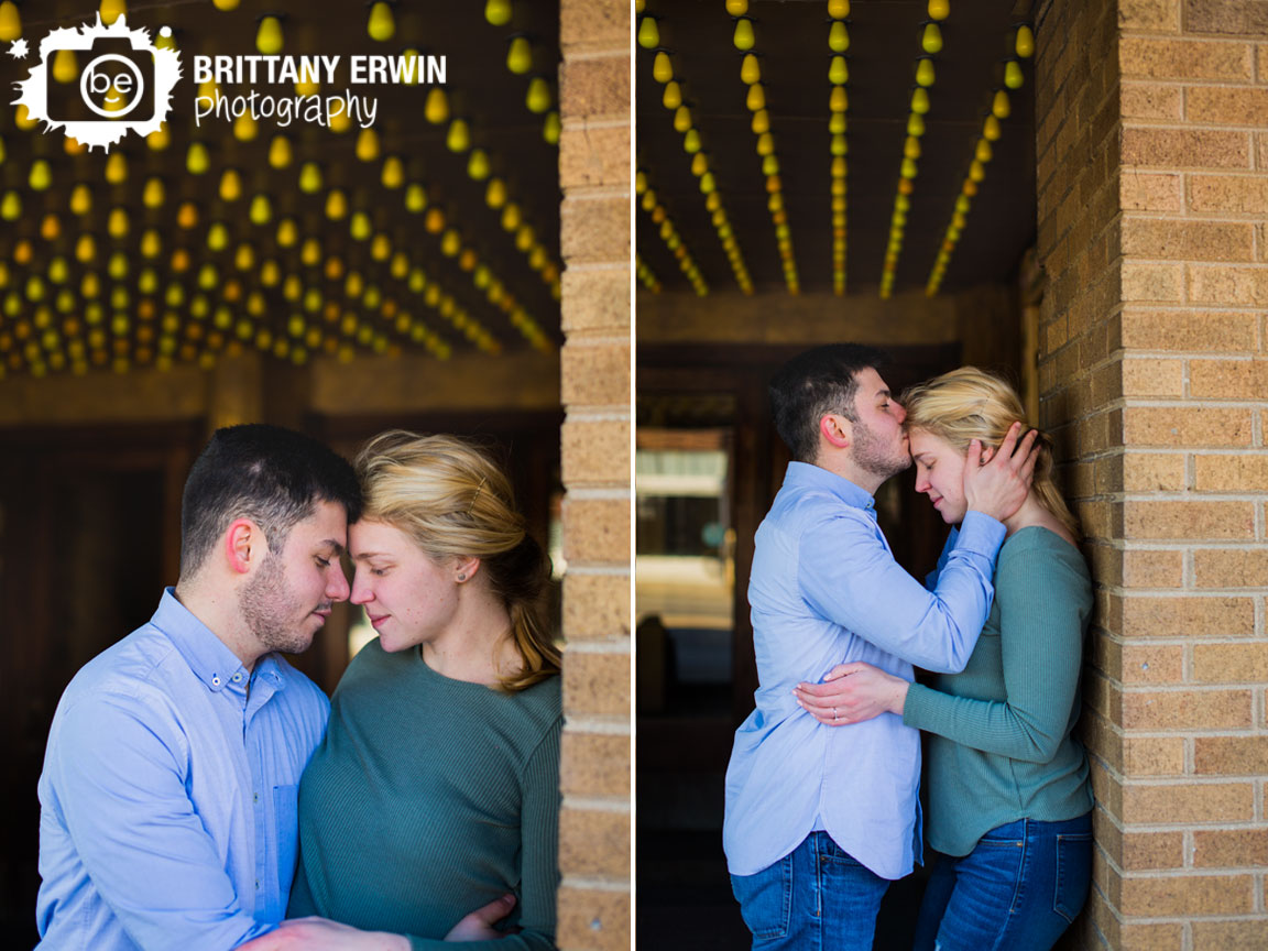 Fountain-Square-engagement-portrait-photographer-theatre-couple-forehead-kiss.jpg