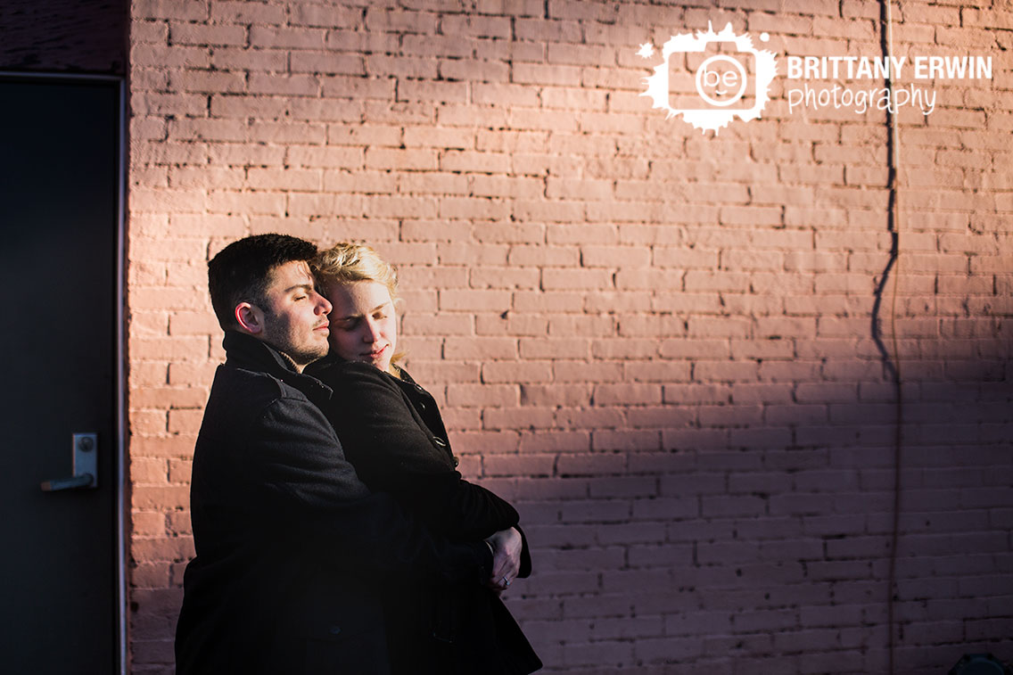 Indianapolis-engagement-photographer-couple-brick-wall-sun-beam.jpg
