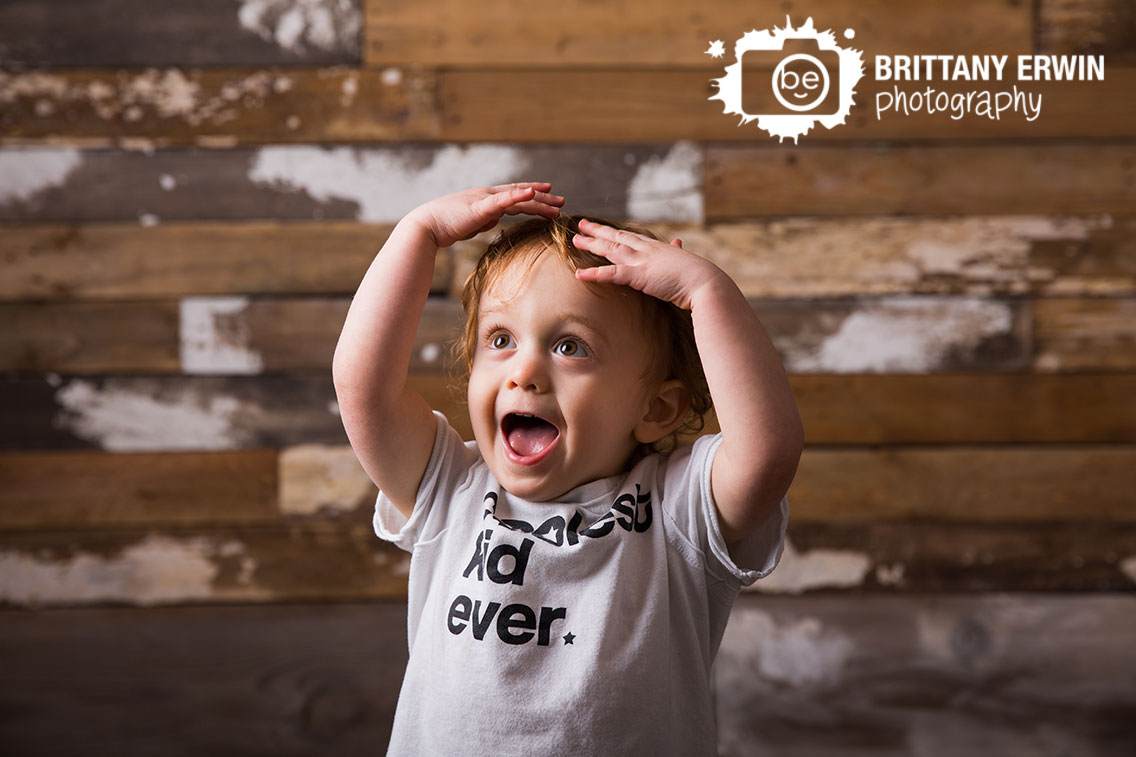 Indianapolis-portrait-studio-photographer-toddler-boy-silly-reclaimed-wood-wall.jpg