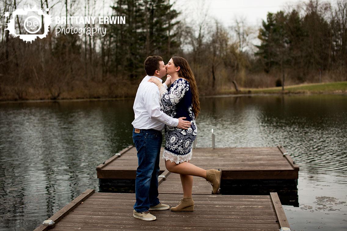 Indianapolis-lakeside-engagement-portrait-photographer-couple-kiss-dance-on-dock-at-pond.jpg