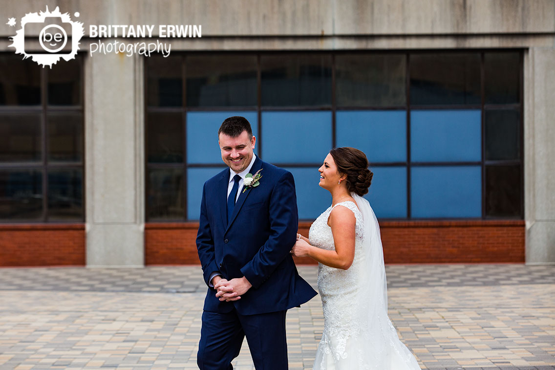 Downtown-Indianapolis-first-look-portraits-wedding-photographer-groom-reaction.jpg