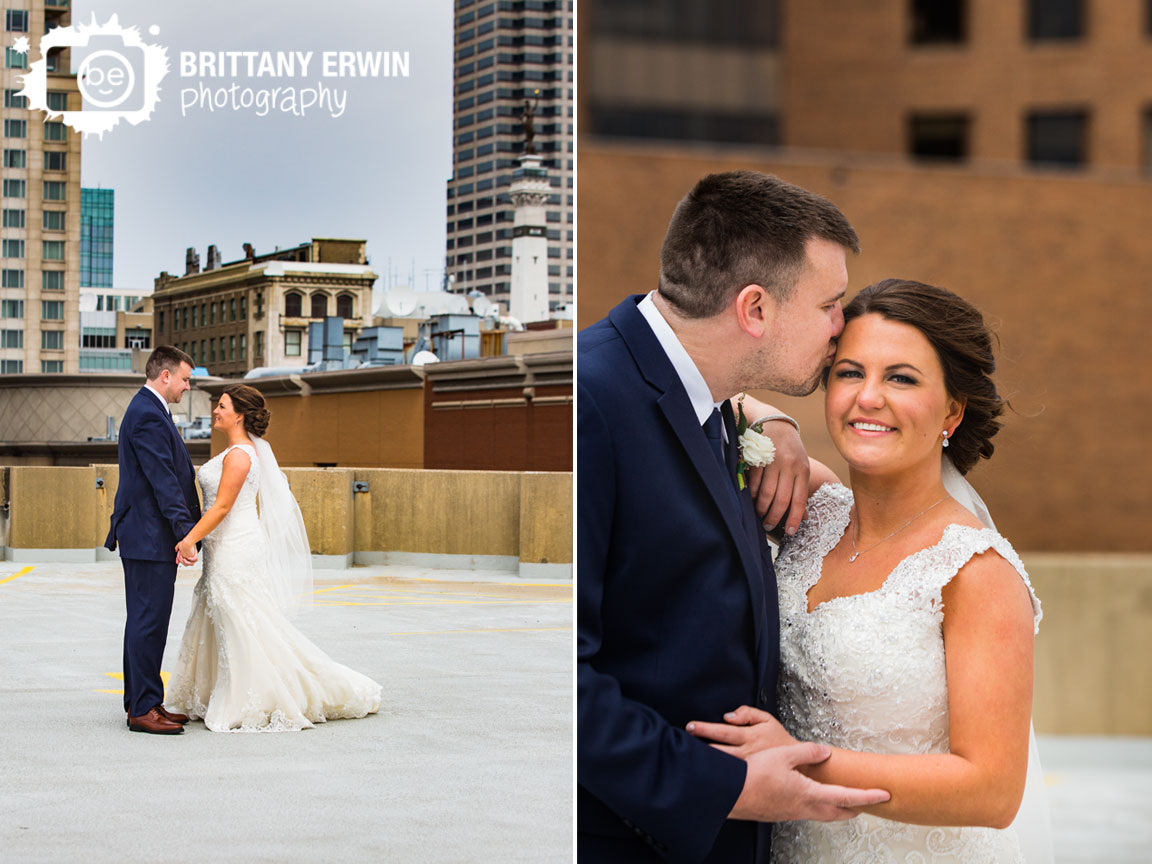 Indianapolis-downtown-parking-garage-skyline-couple-wedding-photographer-cheek-kiss.jpg