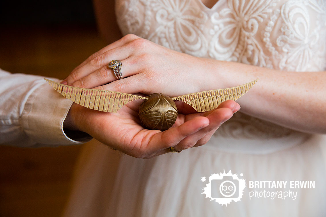 Greencastle-Indiana-3-fat-labs-nerdy-wedding-photographer-3d-printed-snitch-ring-hands-detail.jpg
