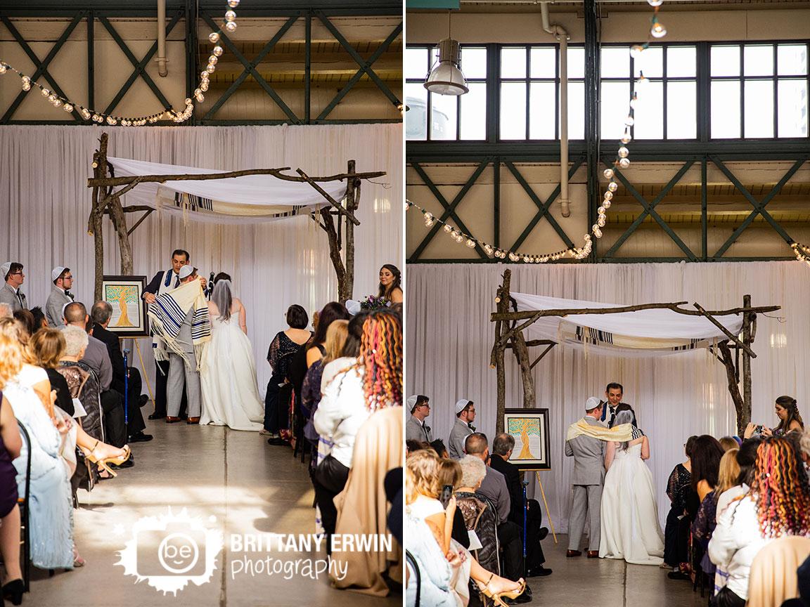 Downtown-Indianapolis-jewish-wedding-ceremony-couple-under-scarf-ketuba-altar-chuppah.jpg