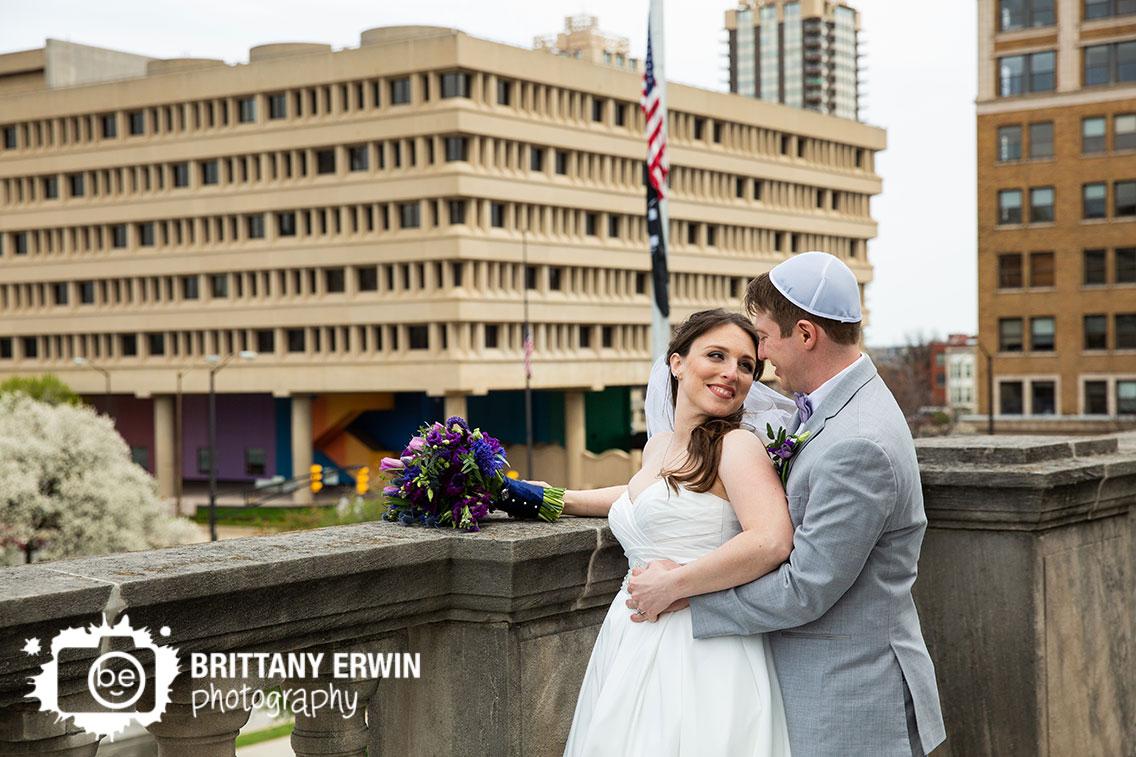 Downtown-Indianapolis-skyline-portrait-wedding-photographer-violets-are-blue-bouquet-couple.jpg