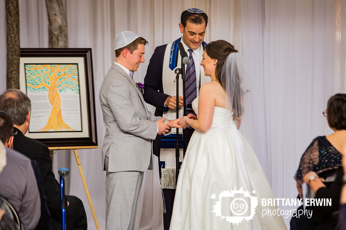Downtown-Indianapolis-wedding-ceremony-photography-couple-exchange-rings.jpg