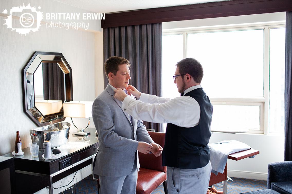 Downtown-Indianapolis-wedding-photographer-best-man-straighten-groom-bow-tie.jpg