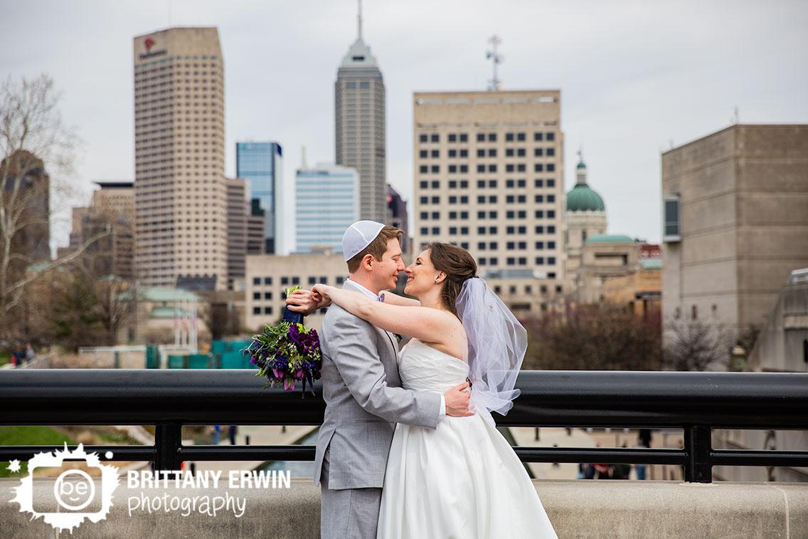 Downtown-Indianapolis-wedding-photographer-skyline-portrait-couple-jerwish-ceremony-purple-bouquet.jpg