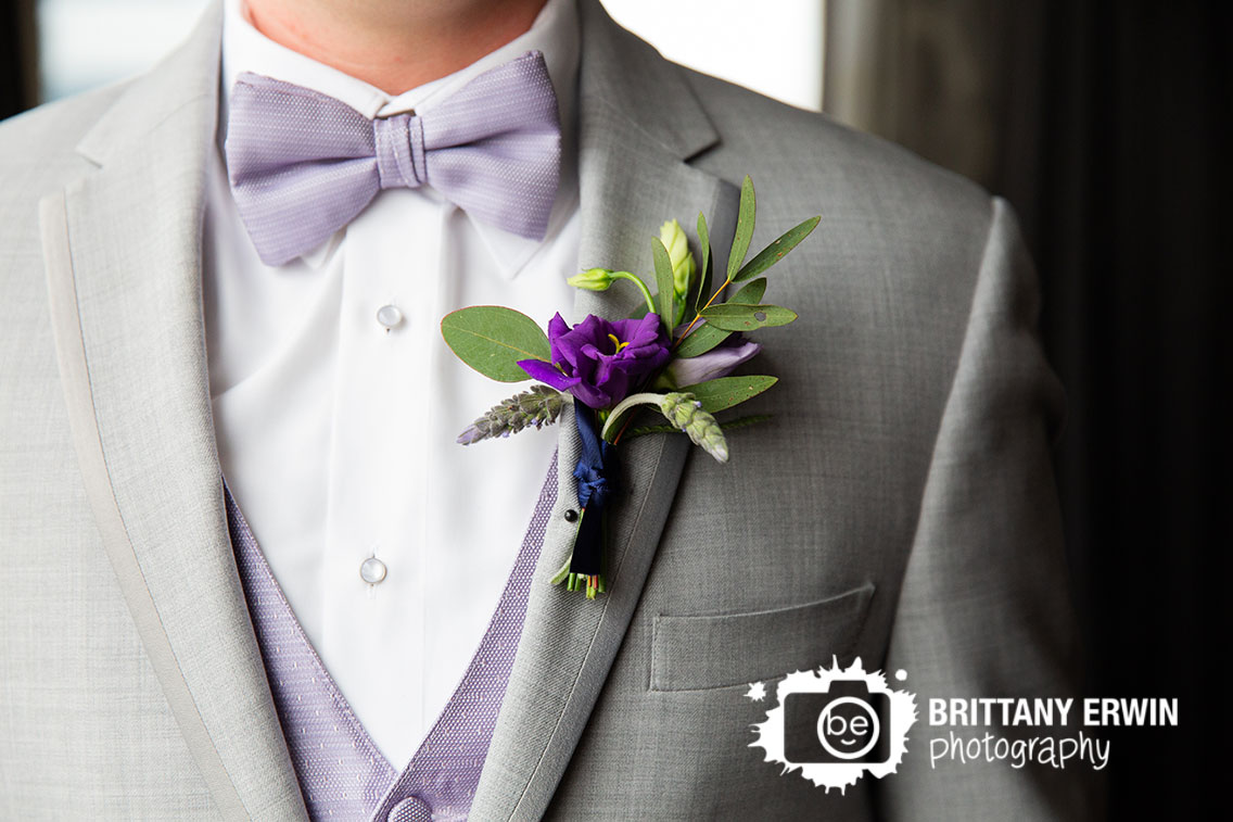 Downtown-Indianapolis-wedding-photographer-violets-are-blue-boutonniere-on-groom-purple-flower-grey-suit.jpg