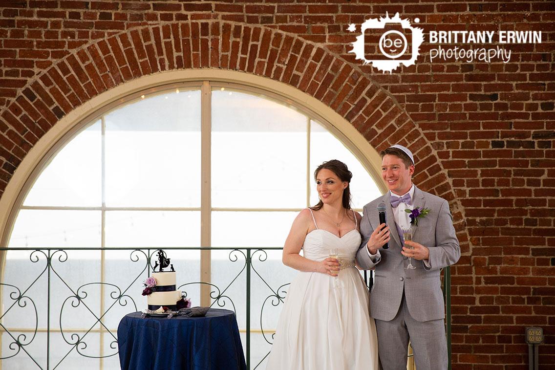 Downtown-Indianapolis-wedding-reception-photographer-city-market-couple-toast.jpg