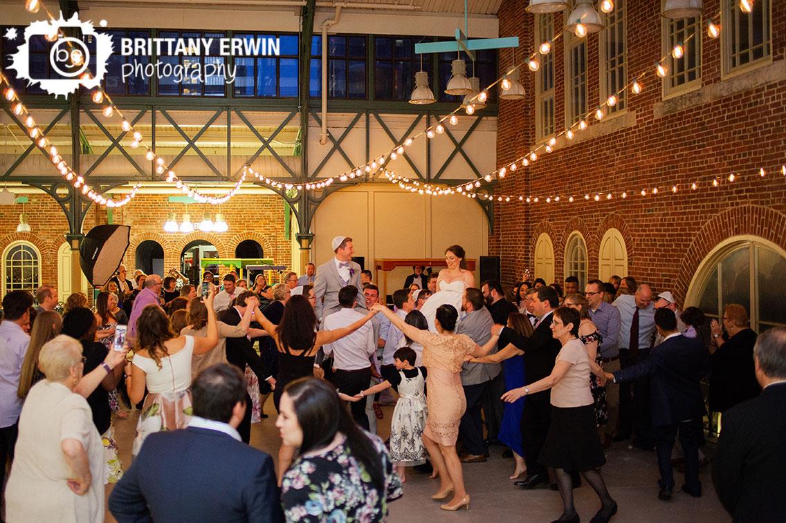 Indianapolis-wedding-photographer-jewish-reception-city-market-hora-couple.jpg