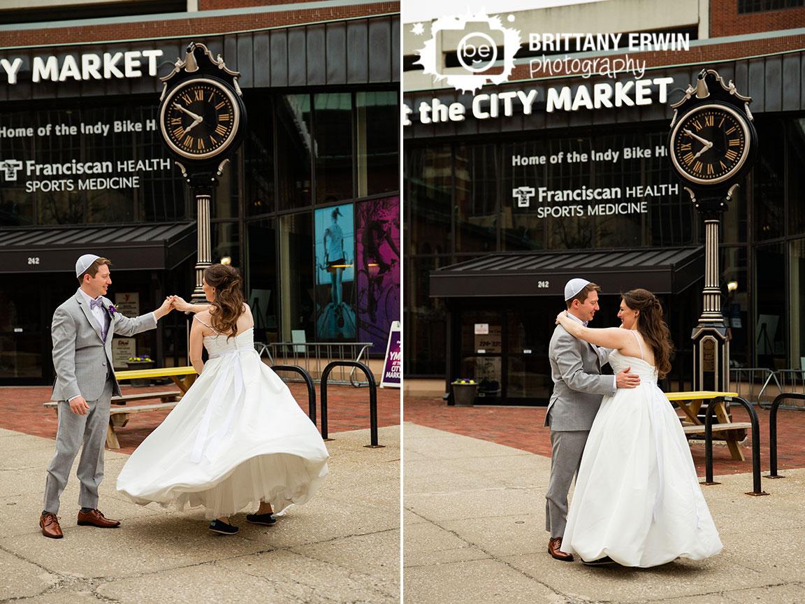 Downtown-Indianapolis-city-market-wedding-photographer-couple-dance-clock-twirl.jpg