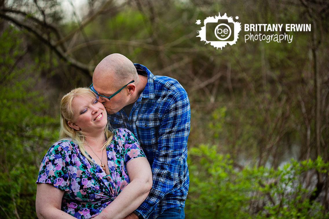 Camby-Indiana-engagement-portrait-photographer-cheek-kiss-couple-by-boat.jpg