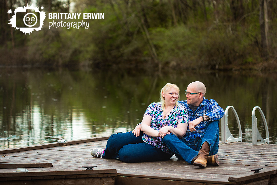 Camby-Indiana-engagement-photographer-couple-on-floating-dock-on-pond.jpg