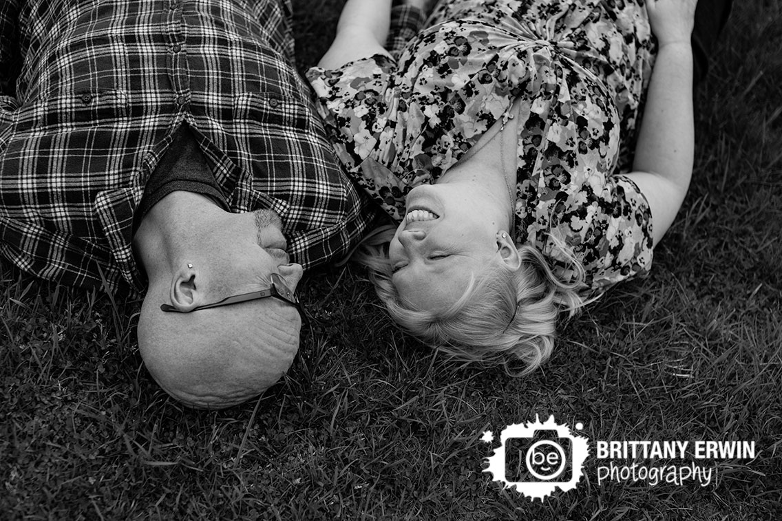 Camby-Indiana-engagement-portrait-photographer-couple-lay-in-grass.jpg
