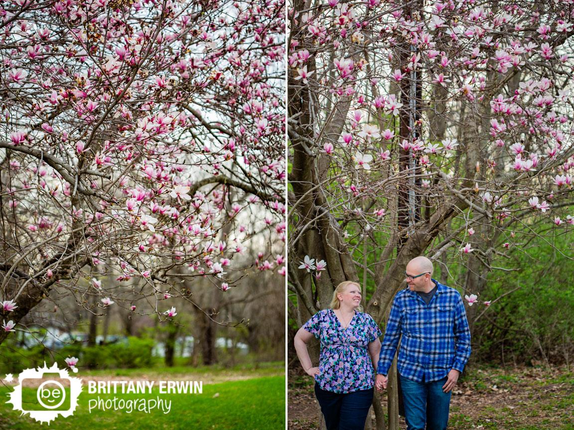 Spring-engagement-portrait-photographer-magnolia-tree-couple-walking.jpg