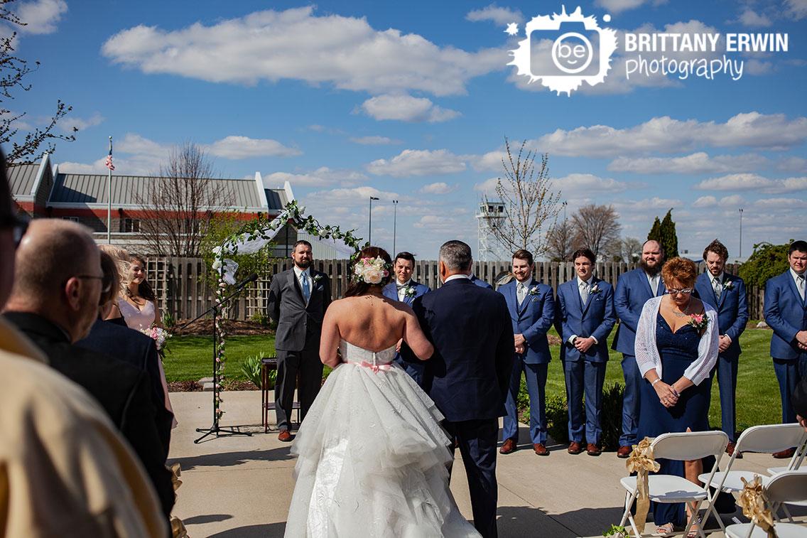 Columbus-Indiana-wedding-ceremony-photographer-couple-outdoor-groom-reaction-bride-down-aisle.jpg