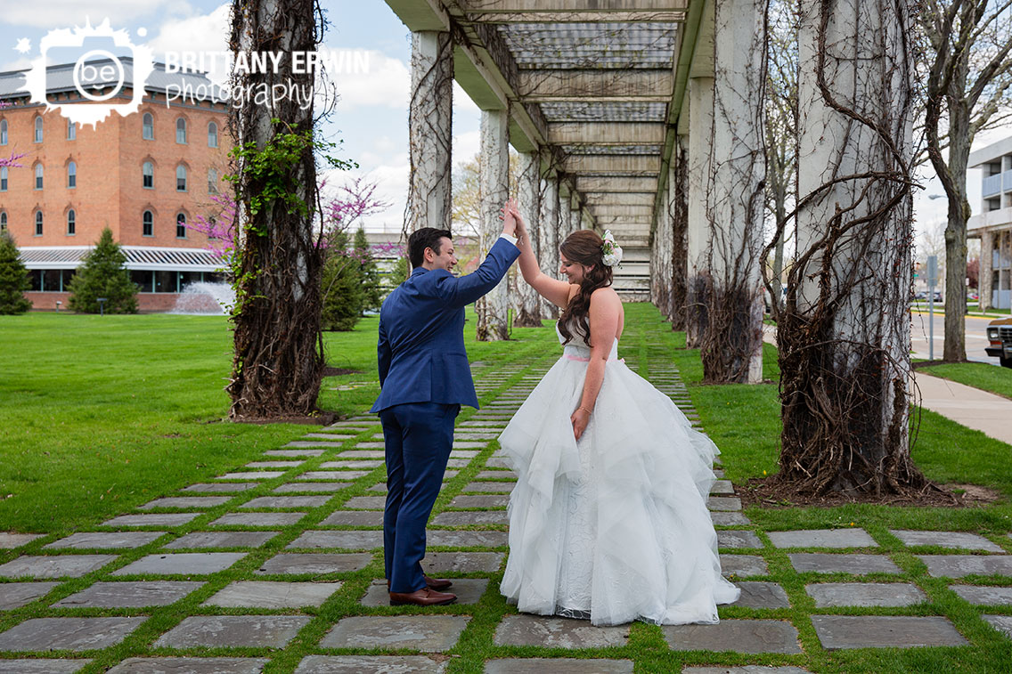 Columbus-Indiana-wedding-photographer-couple-first-look-cummins-high-five.jpg