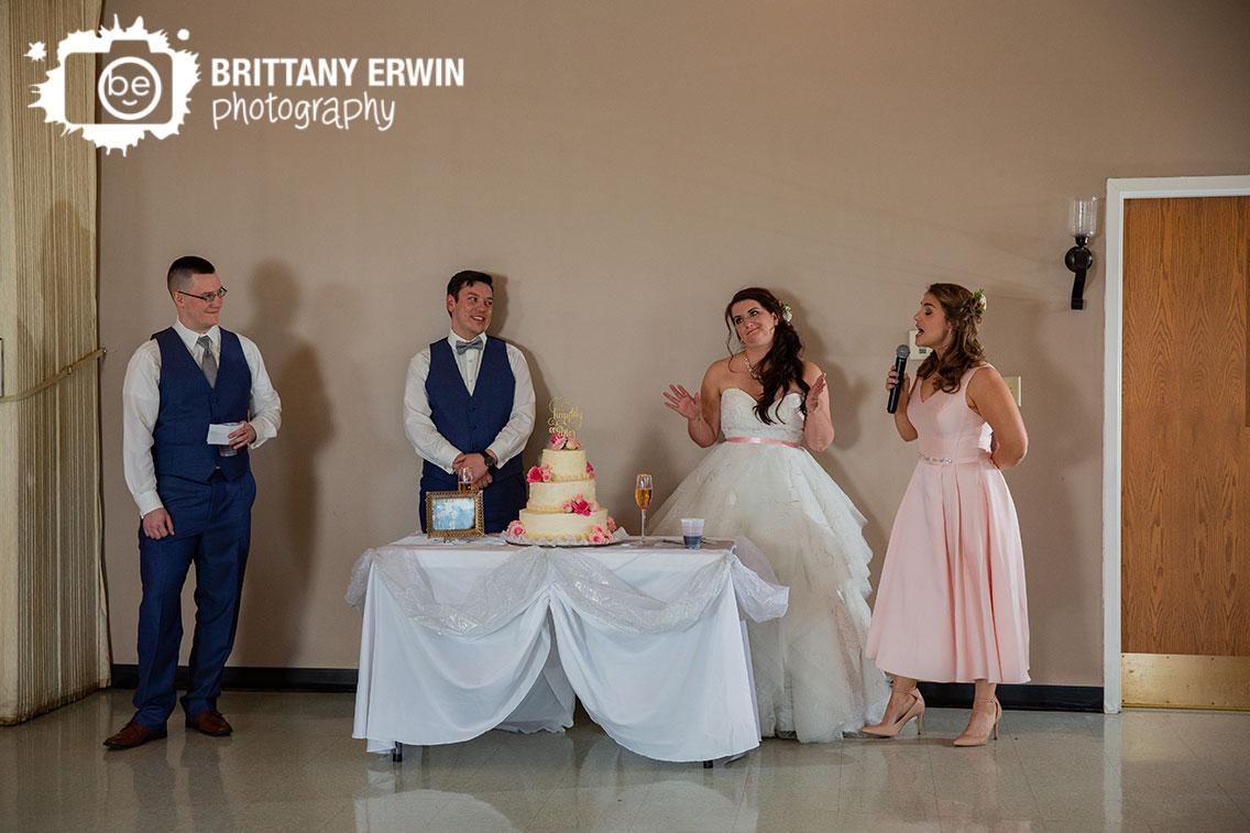 Columbus-Indiana-wedding-reception-photographer-cake-table-toast-maid-of-honor.jpg